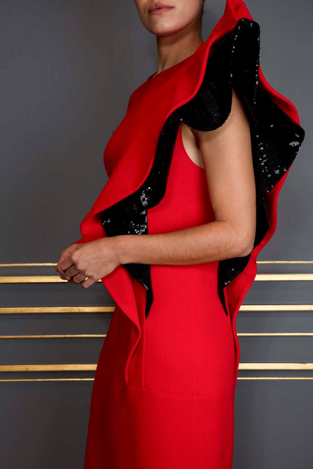 Scarlet asymmetrical dress with sculptural black sequin ruffled sleeve