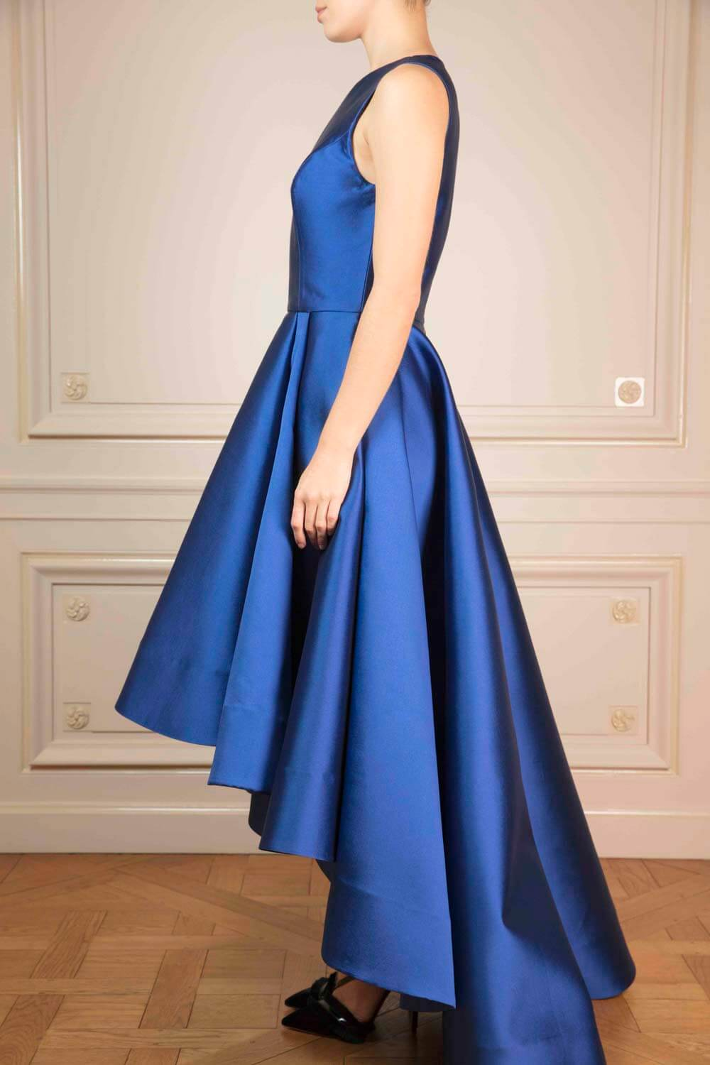 Pleated sapphire-blue Gazar silk gown with voluminous pleated skirt and bias-cut train
