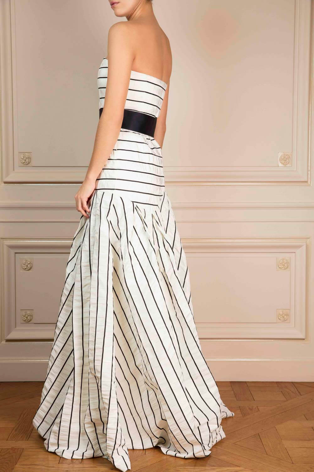 Full-length bustier dress in pinstriped crinkled silk, with an asymmetric bias-cut skirt